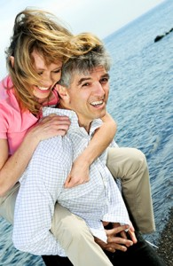 Couple Smiling Implant Dentures - The Fort Collins Dentist