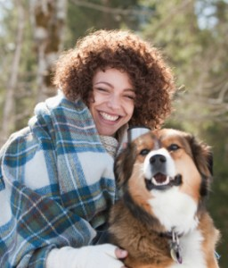 Happy Woman and Dog -  Gum Grafting - The Fort Collins Dentist