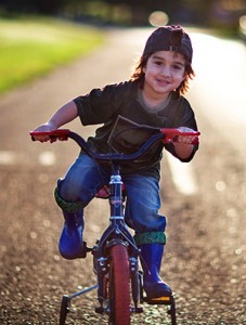 Boy on Bike - Family Dentistry - The Fort Collins Dentist
