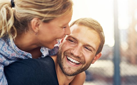 Couple Laughing with Healthy Gums - The Fort Collins Dentist